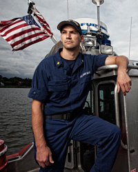 Josh standing on a Coast Guard boat